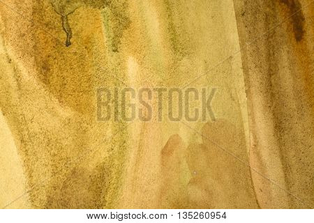 Yellow painted wall with brushstroke textured background