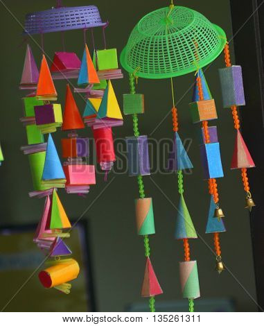 homemade mobile of 3D colored geometric shapes, hanging from plastic sieves, school near Ranot, Thailand