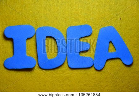 word idea on a  abstract yellow background