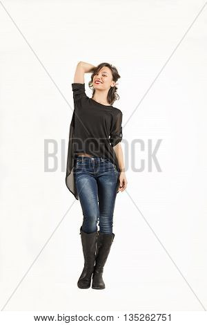 Full length of attractive young brown hair woman posing against white background.