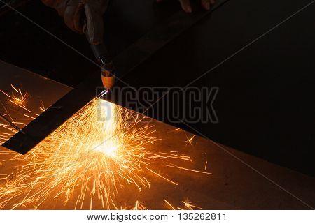 Manual Plasma Cutting Machine On Steel Plate.