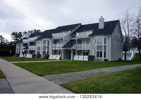 HARBOR SPRINGS, MICHIGAN / UNITED STATES -DECEMBER 24, 2015: The Bay Pointe condominium building stands near the Zorn Park Beach in Harbor Springs.