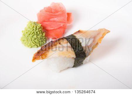 Japanese nigiri with smoked eel with ginger and vasabi