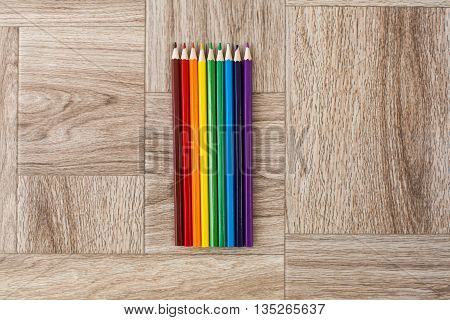 Lots Of Assorted Colors Pencils On Wooden Background