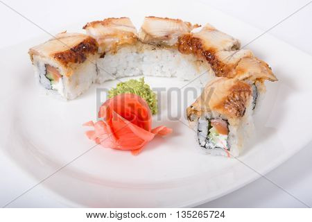 Traditional japanese rolls with eel on white plate