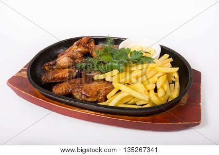 Fried chicken wings served with french fries