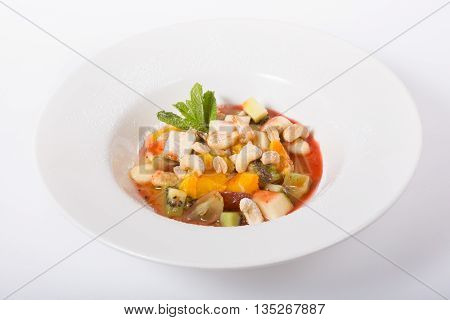 Mixed fruit salad served in white plate