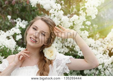 Young beautiful bride in the garden