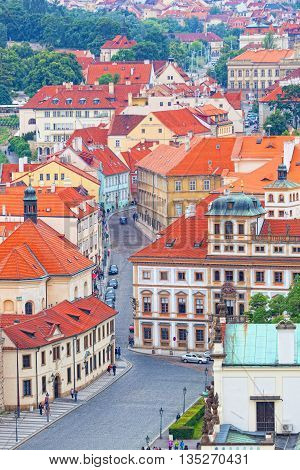 PRAGUE CZECH REPUBLIC - JUNE 11 2012: Cityscape of Old Town Square in Prague. Annually Prague is visited by more than 35 million tourists.