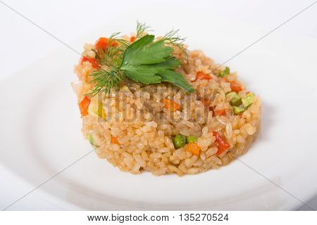 Traditional asian fried rice dish served on a white plate