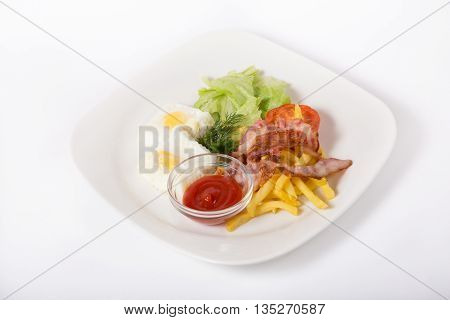 English breakfast plate served on a white plate