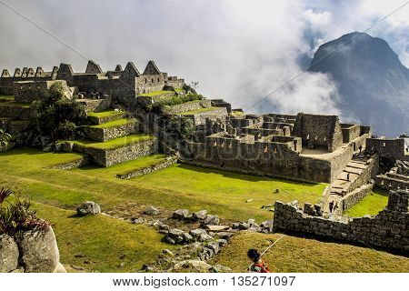 mountain and walls of Machu Picchu to the heights of peru