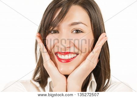 Expressive portrait of a beautiful girl with hands on her face, studio shot on white background