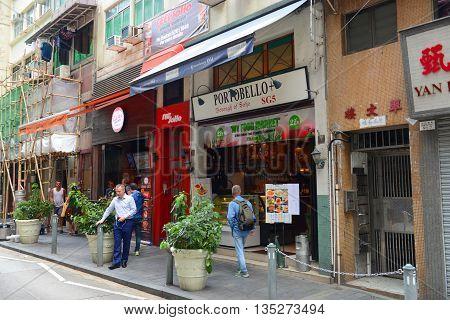 HONG KONG - NOV 9: Colorful shops at Staunton Street on Nov 9, 2015 in Hong Kong. SoHo is an entertainment area get its name of South of Hollywood Road.