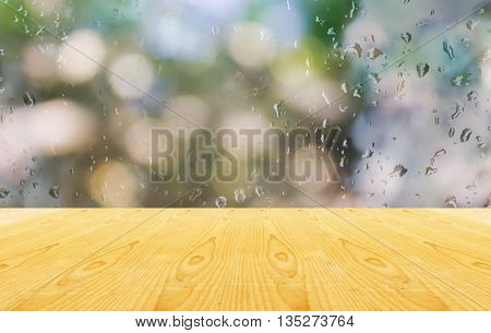 Blank Area Or Space Table Top On Romantic Water Drop At Mirror Or Glass Window And Bokeh Green Backg
