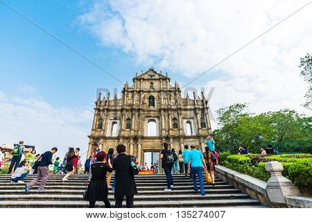 MACAU CHINA - OCTOBER 22 2015: Tourist with The ruins of St. Paul's. Built from 1602 to 1640 one of Macau's best known landmarks. Part of the Historic Centre of Macau a UNESCO World Heritage Site.