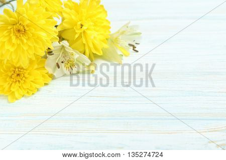 Yellow Chrysanthemum Flowers On A White Wooden Table