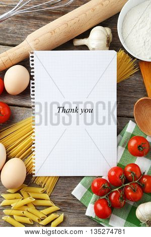 Open blank recipe book on grey wooden background, thank you