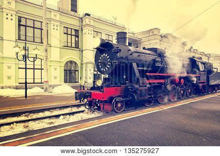 Departure of the retro steam train at evening time.