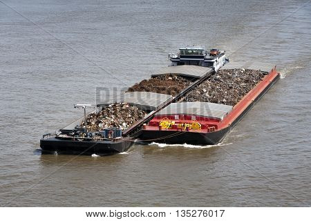 Two barges loaded with metal scrap on the river