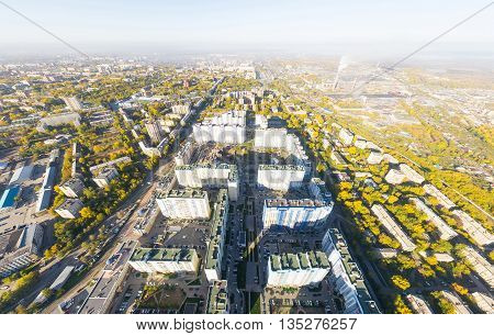 Aerial city view with crossroads, roads, houses, buildings, parks and parking lots, bridges. Copter shot. Panoramic image.