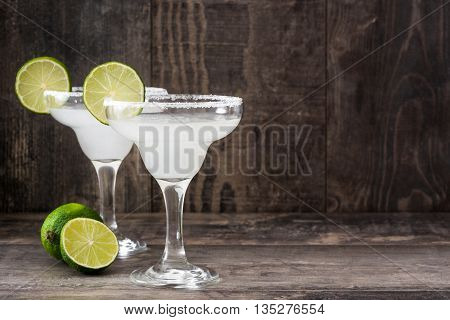 Margarita cocktails on a rustic wooden table