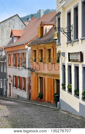 BADEN-BADEN, GERMANY - APRIL 27, 2014: The narrow old street with colored houses. Baden-Baden, Baden-Wurttemberg, Germany.