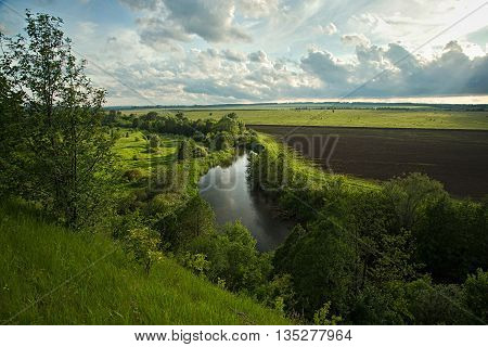 Banks of the river in a countryside in summertime