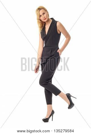 Full Length Of A Beautiful Young Woman In Overall