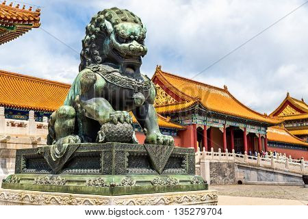 Bronze lion in front of the Hall of Supreme Harmony in Beijing Forbidden City, China