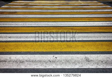 white and yellow lines pedestrian crossing on asphalt closeup in Moscow Russia