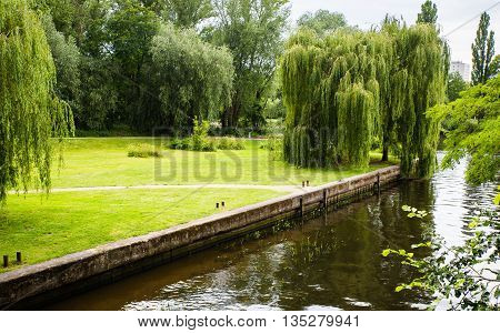 Potsdam Germany Water is full in the canal and both side have tree