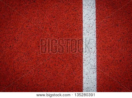 White lane running track with rubber background in stadium