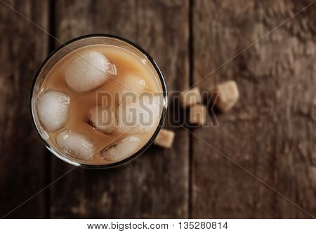 Cold coffee on wooden table
