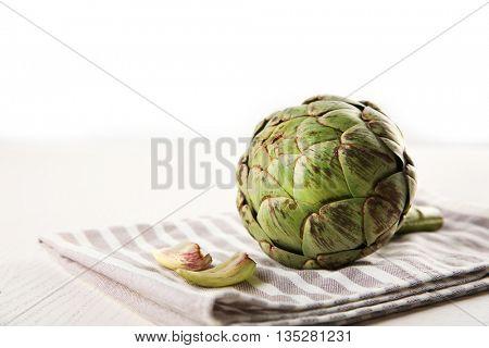 Raw artichoke on napkin