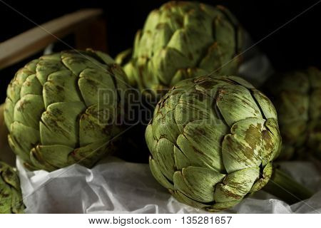 Artichokes in wooden box
