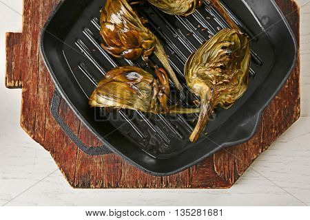 Cooked artichokes on pan