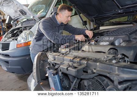 mechanic working on a broken down vehicle