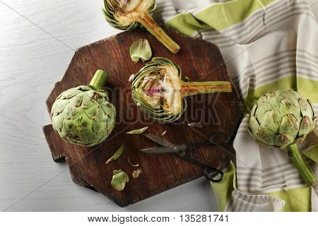 Artichokes on cutting board