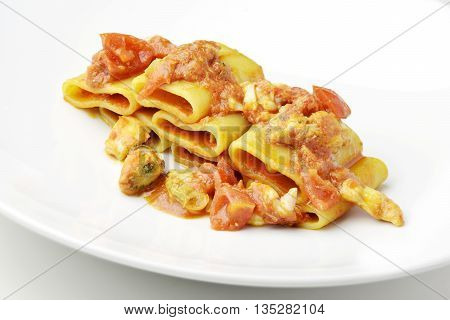 Isolated Dish of Paccheri pasta with seafood chowder sauce