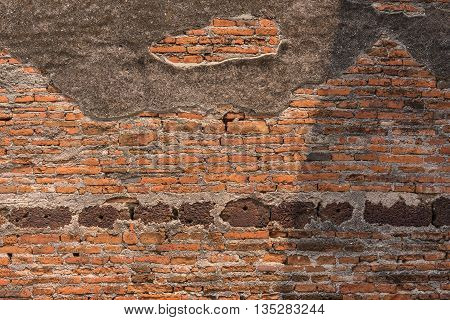 Concrete and brick wall of ancient remains in Thailand.