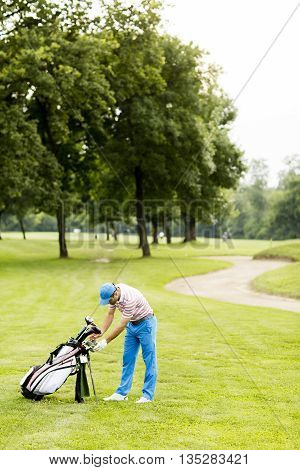 Young Man Playing Golf At The Golf Court