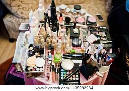 Set Of Brusheslipsticks, Maskara And Eye Shadows. Cosmetics On The Table