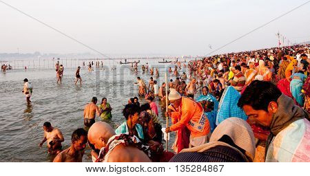 SANGAM, INDIA - JANUARY 27, 2013: Thousands of people come to holy water in the confluence of Ganges and Yamuna during the biggest festival in the world Kumbh Mela on January 27 2013 in Allahabad, India