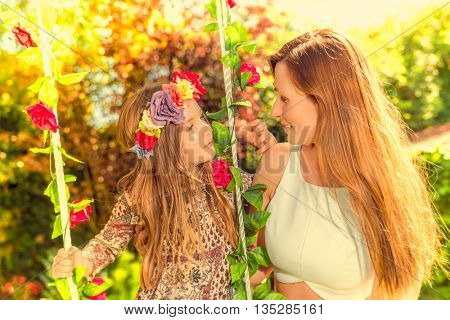 swinging together with tropical flowers