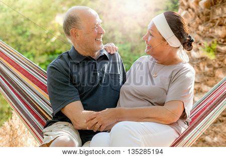resting happy romantic senior couple
