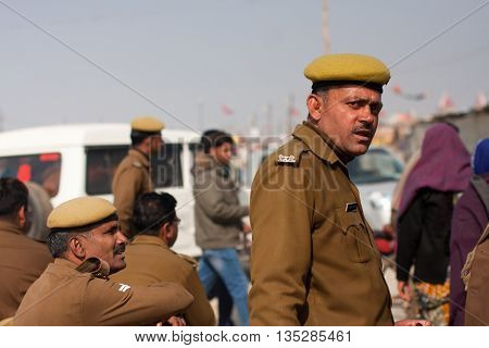 ALLAHABAD, INDIA - JANUARY 26, 2013: Indian police officers guard the biggest festival in the world - Kumbh Mela on January 26, 2013. It is held every 12 years on the banks of Sangam