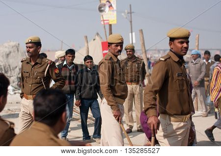 ALLAHABAD, INDIA - JAN 26, 2013: Indian policemen control of the situation at the biggest festival in the world - Kumbh Mela on January 26, 2013. It is held every 12 years at Sangam