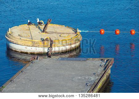 Big Yellow Mooring Buoy Floating On Water