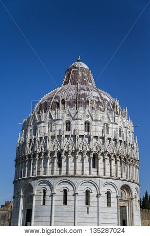 View at Pisa Baptistry in Italy on a sunny day